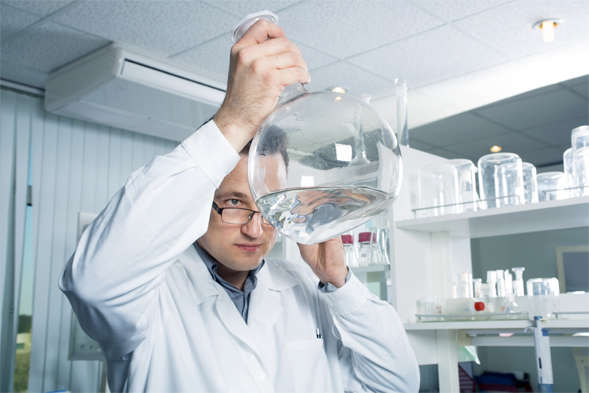 Scientist investigating some water in a beaker